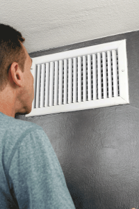 man in front of a clean air vent