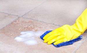 tile and grout cleaning - hand scrubbing tile